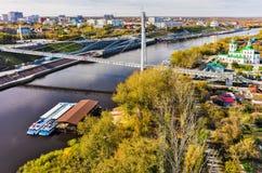 Pedestrian Lovers Bridge on Tura river. Tyumen Stock Images