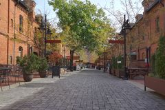 Durham NC retail shops converted from old tobacco warehouses. A pedestrian mall of retail shops converted from old tabacco warehouses in Durham, NC royalty free stock image