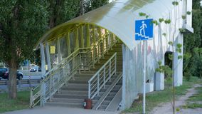 The pedestrian overpass is equipped with a modern ramp for disabled people. iron railing elements and colored glass. infrastructur. E of the provincial Russian royalty free stock photos