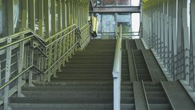 The pedestrian overpass is equipped with a modern ramp for disabled people. iron railing elements and colored glass. infrastructur. E of the provincial Russian royalty free stock photography