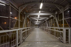 Within the pedestrian overpass at night. You can shoot in the transition part of the series on space odyssey Royalty Free Stock Photo