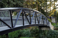Pedestrian overpass to a park above a highway Stock Photo