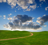 Pedestrian path between green hills Stock Photography