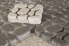 Pedestrian path with paver bricks. Sidewalk pavement. Pedestrian path with paver concrete bricks. Sidewalk pavement stock image