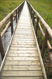 Pedestrian path on wooden poles Stock Photography