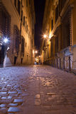 Pedestrian Paths between Buildings in Central Rome at Night Stock Image