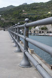 Pedestrian pier with benches and iron classic fences Royalty Free Stock Images