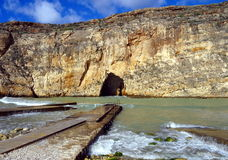 Pedestrian pier at seaside. Pedestrian pier on the sea and high cliffs Stock Image