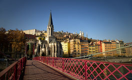 Pedestrian red passerelle St-Georges in Lyon. With St-Georges church in background Royalty Free Stock Images
