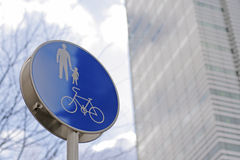 Pedestrian route. Pedestrian and bicycles route sign in a big city-selective focus Royalty Free Stock Photos
