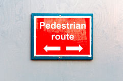 Pedestrian route direction red painted notice board Stock Images