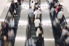 Pedestrian, salaryman Up and down the automatic escalator To travel to work and return home royalty free stock photo
