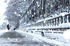 Pedestrian sidewalk the fence winter Stock Photo