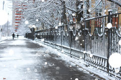 Pedestrian sidewalk the fence winter Royalty Free Stock Photography