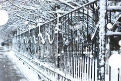 Pedestrian sidewalk the fence winter Royalty Free Stock Photo