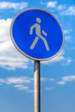 Pedestrian sign. Pedestrian zone sign against blue sky with clouds Royalty Free Stock Image