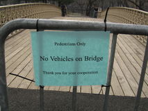 Pedestrian only sign on bridge. Pedestrians Only sign on bridge in Central Park stock photography