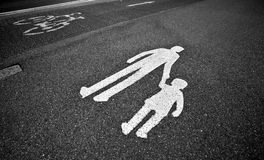 Pedestrian sign on the  pavement/sid. Parental guidance concept - pedestrian sign on the  pavement/sidewalk Stock Images