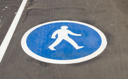 Pedestrian sign on the pavement Stock Images