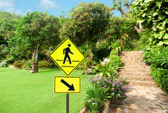 Pedestrian sign with a person walking on yellow Royalty Free Stock Images
