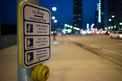Pedestrian sign. With traffic control during the night Stock Photo