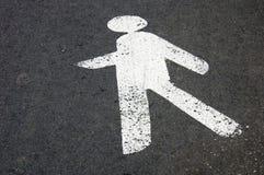 Pedestrian signal. White pedestrian signal painted on the asphalt Royalty Free Stock Photo