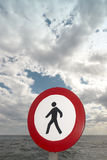 Pedestrian signal in a mediterranean coastine landscape.  Royalty Free Stock Image