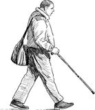 Pedestrian with a stick Royalty Free Stock Image