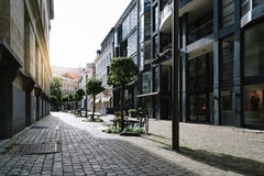 Pedestrian street in Antwerp at sunset with sunlight on backgrou Stock Image