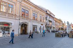 Pedestrian street in the center of old Brasov in Romania stock images