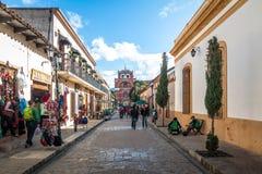 Pedestrian street and Del Carmen Arch Tower Arco Torre del Carmen - San Cristobal de las Casas, Chiapas, Mexico Stock Image