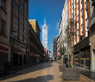 Pedestrian street in Downtown with Torre Latinoamericana on background - Mexico City, Mexico stock photo