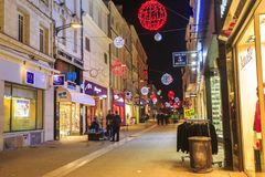 Pedestrian street illuminated by numerous Christmas decoration in the city center of niort. Niort, France - December 05, 2017: pedestrian street illuminated by Stock Images