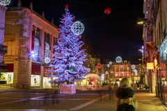 Pedestrian street illuminated by numerous Christmas decoration in the city center of niort. Niort, France - December 05, 2017: pedestrian street illuminated by Royalty Free Stock Image