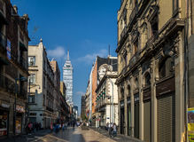 Pedestrian street in Mexico City downtown with Latinoamericana Tower on background - Mexico City, Mexico Stock Image