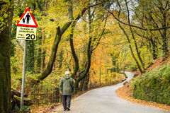 Pedestrian. Strolling up a country road with a ban on motorists driving more than 20 mph Royalty Free Stock Photo