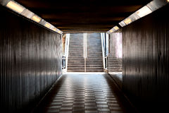 Pedestrian subway (underpass). This is an image of a subway located in Central London with a black and white chequered tile floor, dark colored walls, ceiling royalty free stock photography