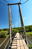 Pedestrian suspension bridge Royalty Free Stock Photos