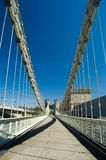 Pedestrian suspension bridge Stock Photos