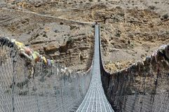 Pedestrian suspension bridge across the Kali Gandaki River. Nepal. Pedestrian suspension bridge across the Kali Gandaki River. Trekking to the Upper Mustang Royalty Free Stock Photos