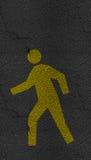 Pedestrian symbol on Asphalt road Royalty Free Stock Images