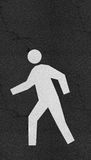 Pedestrian symbol on Asphalt road Royalty Free Stock Image