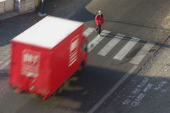 Pedestrian is about to be hit by a truck Stock Photography