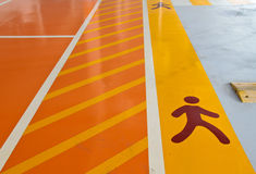 Pedestrian track at a parking lot. Pedestrian walkway at a parking lot Royalty Free Stock Photos