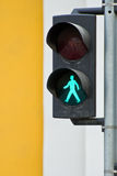 Pedestrian traffic light. With the green light lit Royalty Free Stock Photos