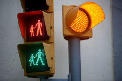 Pedestrian traffic light with all the lights. Royalty Free Stock Photos
