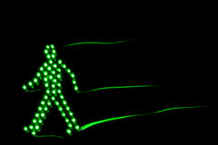 Pedestrian traffic light green. Isolated on a black background Stock Photos
