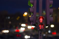 Pedestrian traffic light red with countdown. Background night city Royalty Free Stock Image