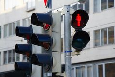 Free Pedestrian Traffic Light Showing Red And City In The Background Royalty Free Stock Photos - 102031548