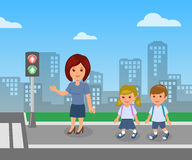 Pedestrian traffic light. The teacher shows and explains the rules of road safety for children pupils Stock Images